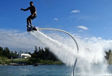 A flyboarder above the water