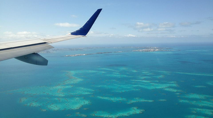 Airplane Flying Over Coral Reef