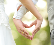 A Bride and Groom Holding Their Hands in a Heart