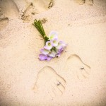 Wedding Rings and Hand Imprints in Sand