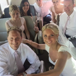 Group Photo on the Wedding Bus